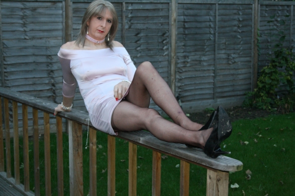 Ready for CGs - My pink satin mini dress perched on the decking handrail, Satin,ff nylons,sneak peak panties, Dolled Up